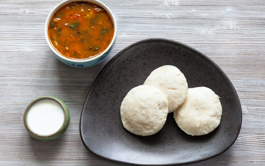 Idli Sambar steamed dumplings with sauses on table